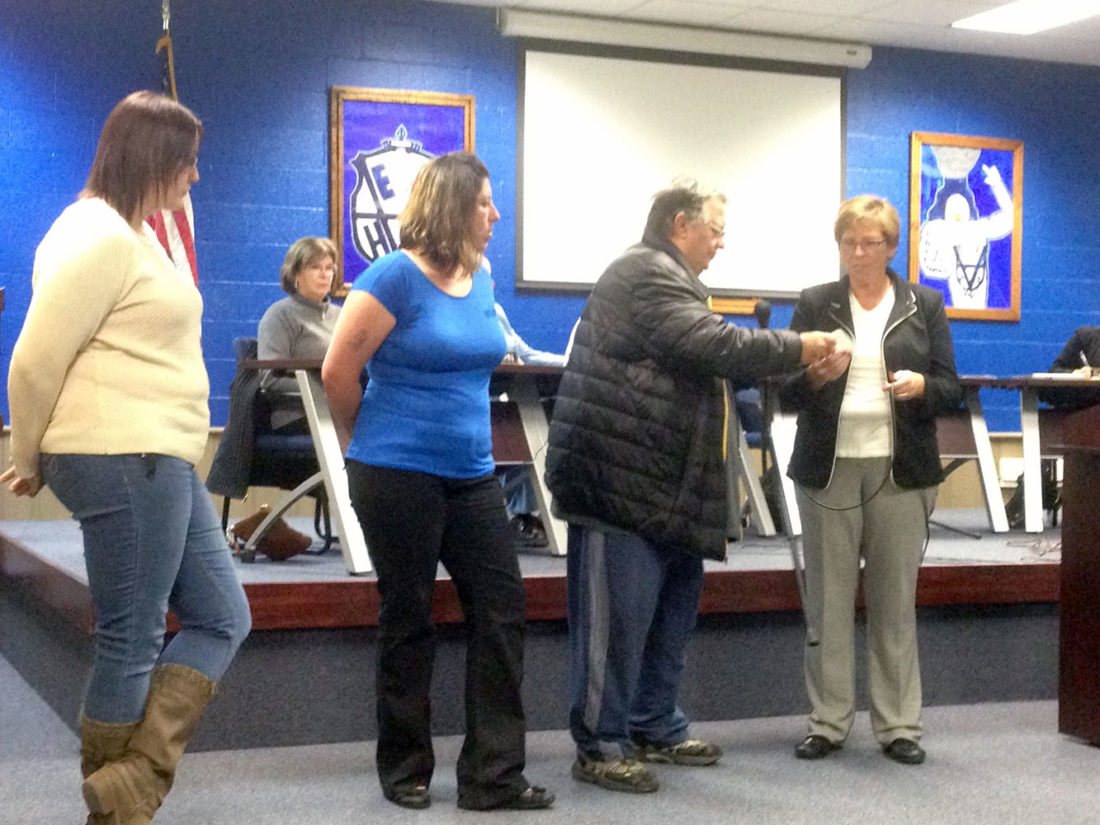 East Liverpool Schools Treasurer Kathy Jo Laughlin (right) accepted a $600 check Monday night from representatives of the Little Potters Football organization (from left) Vice President Heather Kirby, Secretary Anita Lovett and Athletic Director Bob Ramsey. Not pictured are Little Potters President Tom Lovett and Assistant Athletic Director Shane Foster. The donation was returned by the school board. (Photo by Jo Ann Bobby-Gilbert)