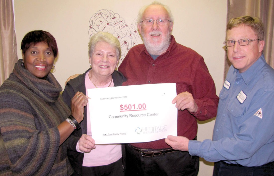 Heritage Thermal Services Vice President of Operations and General Manager Stewart Fletcher, right, presents company's donation to mark 500 likes of the company's Facebook site. Receiving the check are Community Resource Center Executive Director Denise Taylor, left, with Margaret and Robert Brock, Jr. (Submitted photo)