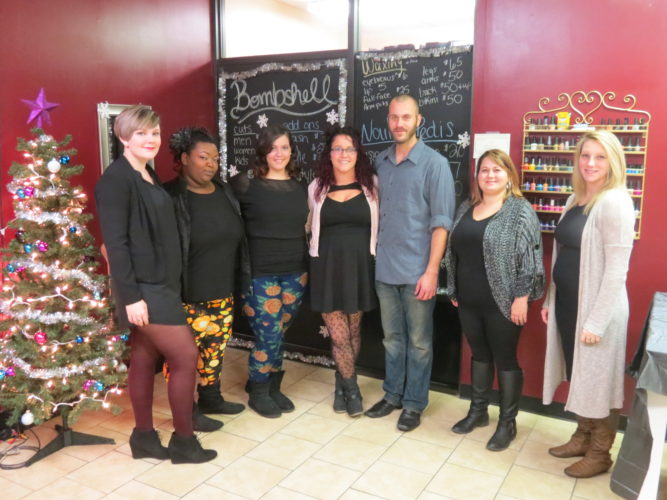Bombshell Beauty Salon owner Shayne Beagle (center) is shown with the staff of the East Liverpool business, which includes (from left) Katie Channels, Cindy Wall, Lexi Cooke, Jared Smith, Brittany Cunningham and Markie Lowe. (Photo by Steve Rappach)