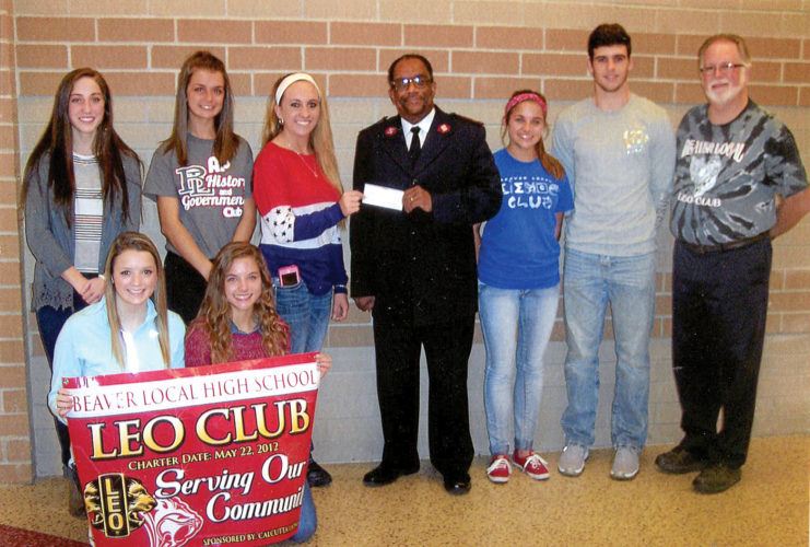 Officers of the Beaver Local Leo Club donated $100 to Major Douglas McGuire of the East Liverpool Salvation Army in support of its Thanksgiving program. Area families in need of assistance receive food from the Salvation Army every year. Pictured are Leo Club officers (front, from left) Sidney Bowyer and Emily Beck; and (back) Kenzie Delposen, Megan Buchheit, Konnor McCoy, Major McGuire, Grace Beck, Logan Bouscher and club advisor Jerry Barnes. (Submitted photo)