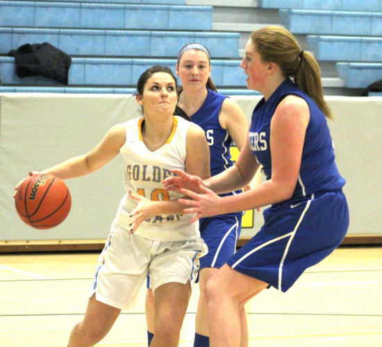 Oak Glen's Maisie Witherow tries to put a shot up over East Liverpool's Emma Ludwig (right). Also shown is East Liverpool's Cyna Burton. (Photo by Joe Catullo).