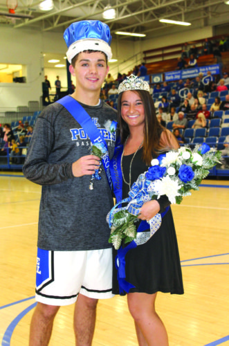 East Liverpool's Aaron Bombich (left) and Madison Prince were crowned the Winter Homecoming king and queen during halftime of the Potters' matchup with Brooke on Friday. (Photo by Joe Catullo)