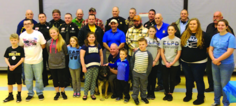 "The East Liverpool Christian School held its first ever ""Cater to the Cops"" Dinner, on Jan. 14, to serve local Police Departments. The event was sponsored by CPR Ministries of Chester and BeUnitedInChrist.com global outreach ministry. The officers and their spouses from East Liverpool, Hancock County Sheriffs Office, St. Clair Township, Liverpool Township and the Chester Police Depts., were treated to a dinner of BBQ ribs, chicken, pork loin, pulled pork and sides form MJB Barbecue of East Liverpool; lasagna, pizza, salad and breadsticks from Country Boys Pizza in New Cumberland; and desserts from Frank's Pastry in Chester. Several officers were quoted as saying, ""It's great to just be able to share a meal with other Police Departments all in the same place."" The students waited tables and served drinks and desserts to their guests. There was a large banner made by Campbell Signs for each of the officers to sign. It will be hung in the school and the students and staff will pray for the protection of our officers. The hit of the night came when the Hancock County K9 Officer Oden showed up. The East Liverpool Christian School would like to thank the Police Departments for the great attendance and all those who helped make this a huge success. (Submitted photo)"