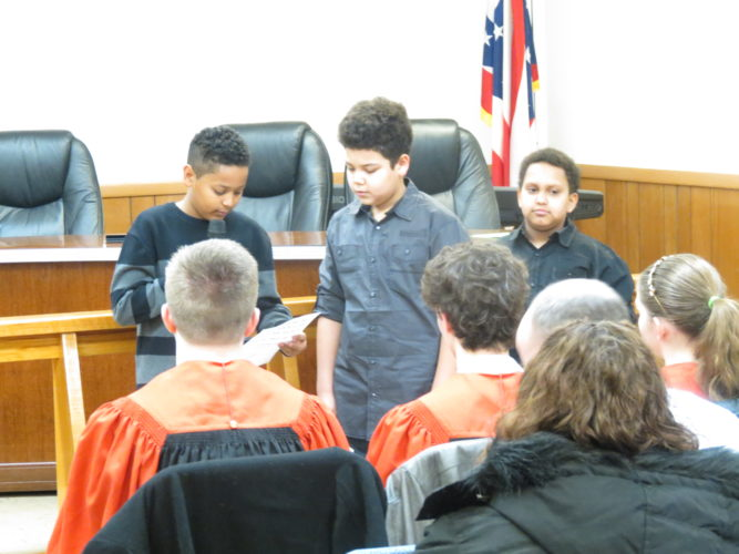"Elijah Douglas (from left), Colton Carter and Xavier Pullie recite Dr. Martin Luther King Jr's landmark ""I Have a Dream"" speech during Wellsville's 25th annual birthday program inside council chambers at Village Hall. (Photo by Steve Rappach)"
