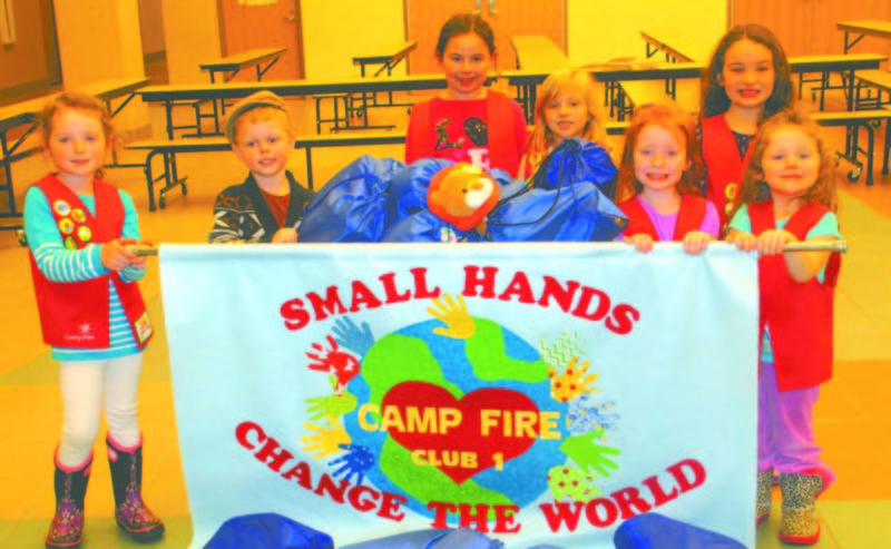 Camp Fire club members pictured (from left) are Mave Hasson, Maci Price, Teagan Miller, Kaidynn Edmond, Aubrey Russell and Olivia Miller. Participating in the service project, but not pictured, were Giada Circelli and Gracie Knepper. Mya Hasson is the club leader. (Submitted photo)