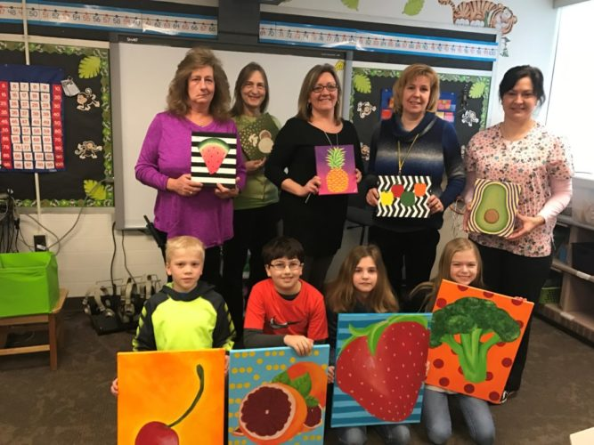 The Oak Glen High School Advanced Art class students created paintings for the New Manchester Elementary School Wellness Committee to promote good nutrition. The students designed and painted pictures representing various fruits and vegetables to be hung in the New Manchester Elementary School cafeteria to remind students of healthy food choices. (Submitted photo)