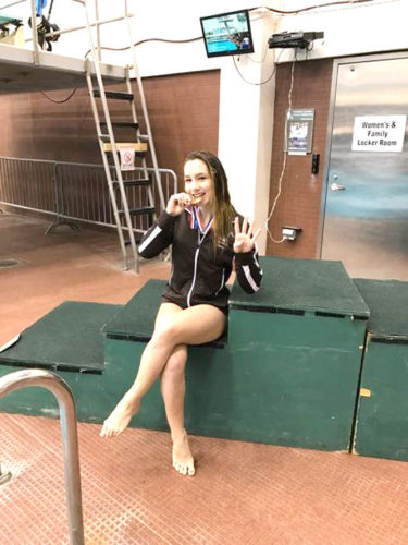 East Palestine's Faith Anderson celebrates after qualifying for her fourth state diving meet last week. (Submitted Photo)