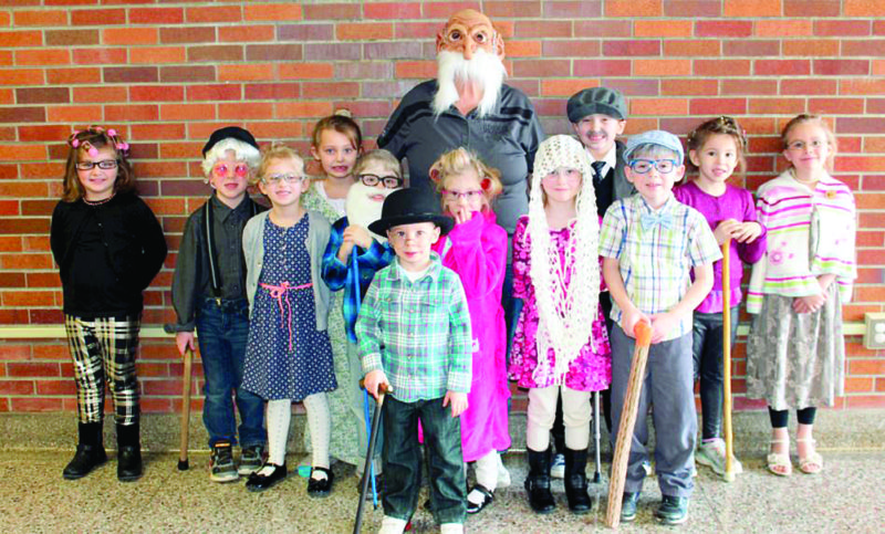 Students in Michelle O'Karma and Jan Keeder's kindergarten classes at Stanton Elementary celebrated 100 days of school on Feb. 17 by dressing as centenarians and performing a series of themed activities. Pictured are (front) Gavin Cavanaugh; (middle, from left) Emily Kireta, Kaleb Marker, Halee Fish, Greyson Martin, and Ethan Warren; and (back) Teagan Basinger, Skyler Buckel, teacher Jan Keeder, Taylor Shasteen, Easton Willoughby, Cabella Hudson and Jenna Workman. (Submitted photo)