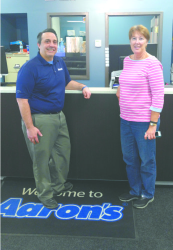 The 13th annual United Way NASCAR Fundraiser is 1 p.m. Sunday at East Liverpool Elks Lodge. Cost is $10 per person. Event includes cash bar, live auction, food, and 50/50 drawing. Also a chance to win an Amazon Echo. Pictured are sponsor Steve Harrington, manager of Aaron's Sales & Lease, and Diane Johnson, director of United Way. (Submitted photo)