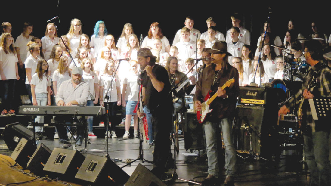 "Beaver Local Middle School Choir shared the stage with The Full Circle Band during their performance of Foreigner's ""I Want To Know What Love Is"" during the second annual Rock the School benefit concert Wednesday at the Beaver Local Auditorium. Seated at the keyboards in front of the choir is Shannon Wickline, keyboardist for the Charlie Daniels Band, while playing the red guitar is Chris Anderson, guitarist for The Outlaws, both of whom were special guest performers for the night. (Photo by Steve Rappach)"