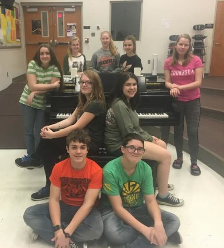 The Vocal Music Department of the Wellsville Junior/Senior High School will hold a chicken dinner 3-7 p.m. Thursday. The dinner will be $8.00 at the door and held in the school's auditeria. $6.00 pre-sale tickets may be purchased from the school's choral director, Aaron Bunfill, or from an upperclassman choral student. The dinner will be accompanied by brief entertainment at 6 p.m. when select solo and ensemble students from both senior high and junior high will present a brief concert. Proceeds will benefit the department's annual trip to the Cedar Point Choral Festival. Pictured is the junior high show choir. Students are, (front, from left); Israel Sluder and James Harmon; middle row; Rhiannon Rodgers-Hart and Paige Green; back row; Abby McGinnis, Jenna McNicol, Emma Smith, Greta Cartwright and Madison Corey. (Submitted photo)