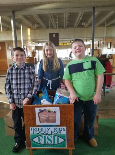 Trinity Kids at Trinity Presbyterian Church, East Liverpool, took part in the Souper Bowl of Caring Drive to feed the hungry. They collected 132 food items and $108 in cash for our local FISH organization. Pictured (from left): Brody Vulgamore, Peyton Vulgamore, and Joshua Dissette. They are part of the Trinity Kids and Triniteens Sunday school classes. (Submitted photo)