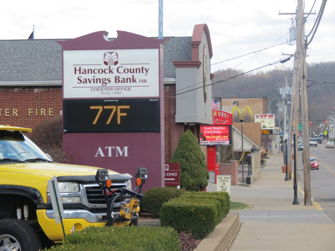 Temperatures reached into the mid-70s Friday afternoon, as indicated here on the Hancock County Savings Bank sign in downtown Chester. But the warmth will be gone soon, especially overnight, as temperatures are predicted in the 30s this weekend. (Photo by Steve Rappach)