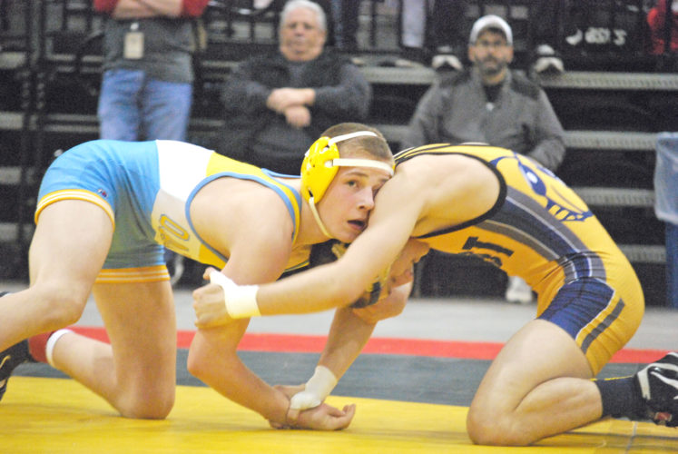 Oak Glen freshman Peyton Hall grapples with East Fairmont's Cole Laya in the 120-pound Class AA/A final on Saturday at the West Virginia State Wrestling Tournament in Huntington. (Special to the Review)
