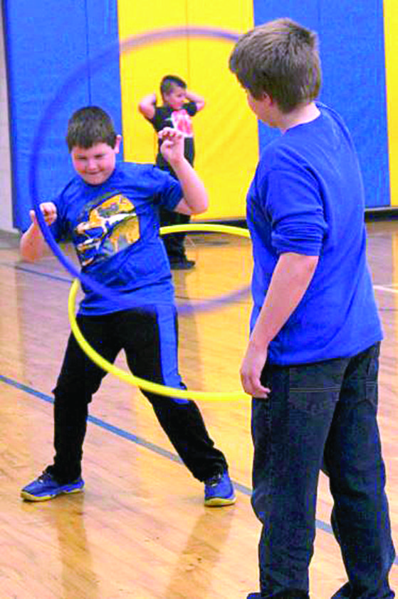 "Students at Southern Local Elementary School got moving Friday to raise money for the American Heart Association's annual ""Jump Rope For Heart"" campaign. A jump-a-thon was held  with jump ropes, hula hoops, dancing, and an obstacle course during each grade level's special time. Monetary collections have been extended until March 3, but more than half of the $5,000 goal has been raised. Among those enjoying the fun were third-graders Evan Householder and Brock Corbin. (Submitted photo)"