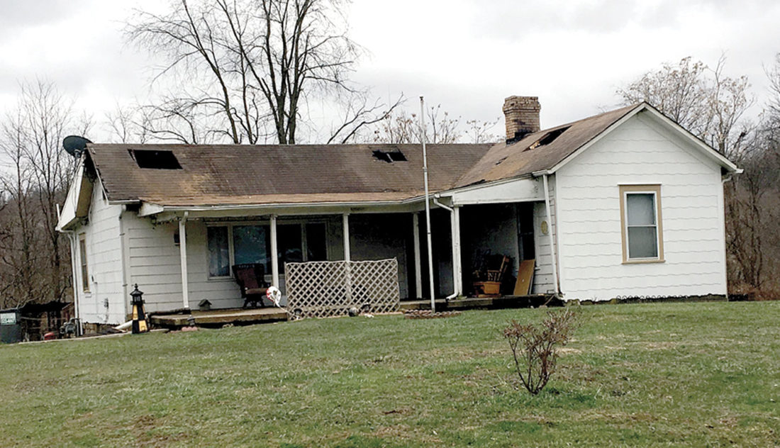 Pictured is the condition of the house located on 18th Street Heights in Yellow Creek Township following a fire that took place shortly after midnight Monday. Crews from Wellsville volunteer, Wellsville village, Highlandtown volunteer and Liverpool Township assisted in the blaze. (Photo by Steve Rappach)