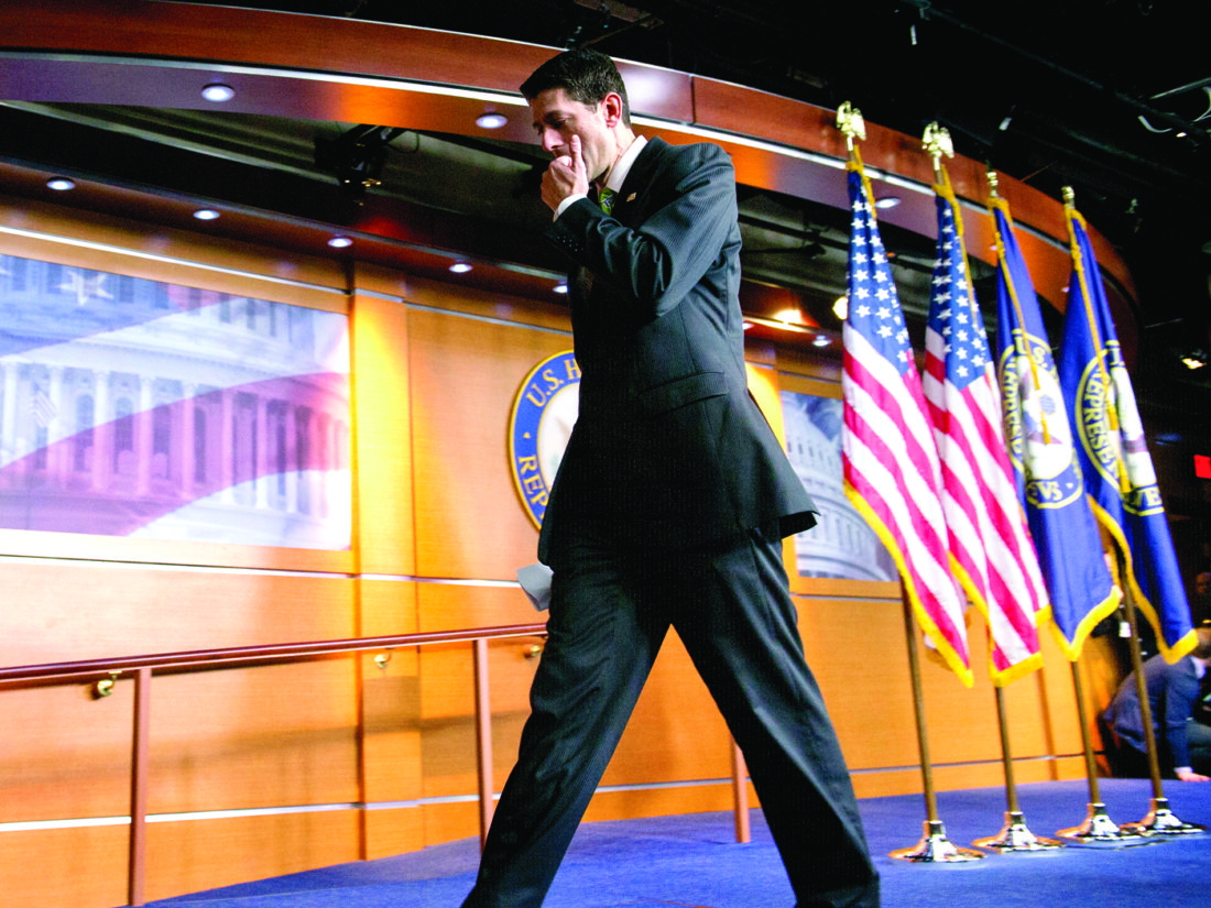 """House Speaker Paul Ryan leaves after telling the news media Friday he has pulled the health care overhaul bill. """"We came really close today, but we came up short,"""" he said. (AP Photo/Cliff Owen)"""