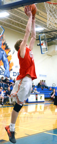 Wellsville's Justin Miller goes up for a dunk in the County Classic on Tuesday in Lisbon. (Photo by Patti Schaeffer)