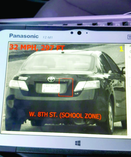 A vehicle captured on the traffic cam by Patrolman Fred Flati showed in clear detail the car, its license plate number, and the location and the speed. The plate number was purposely blurred by the newspaper. In this school zone, the speed limit is 20 mph, and drivers are being allowed six miles over that limit before being cited. (Submitted photo)