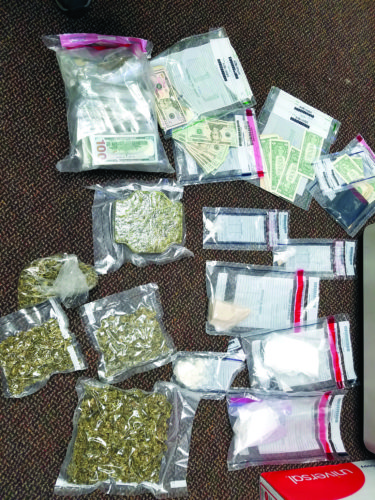 These drugs, marijuana and money were seized from a Lisbon residence Wednesday. (Photo courtesy of the county DTF)