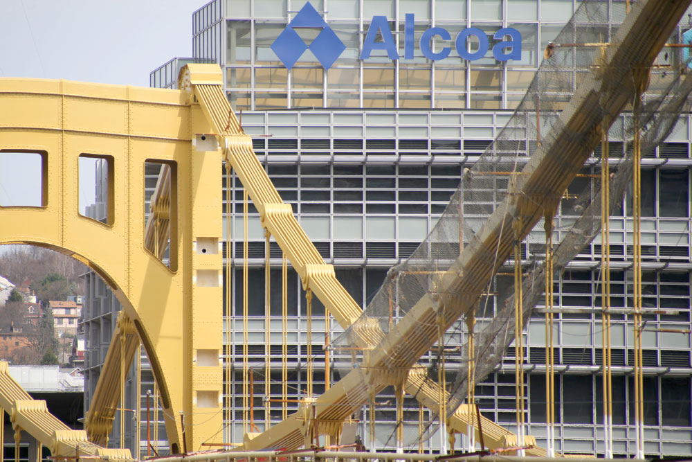 This April 3, 2017, file photo, shows the Alcoa Corporate Center behind the Seventh Street Bridge, also known as the Andy Warhol Bridge, in Pittsburgh.  (AP Photo/Keith Srakocic, File)
