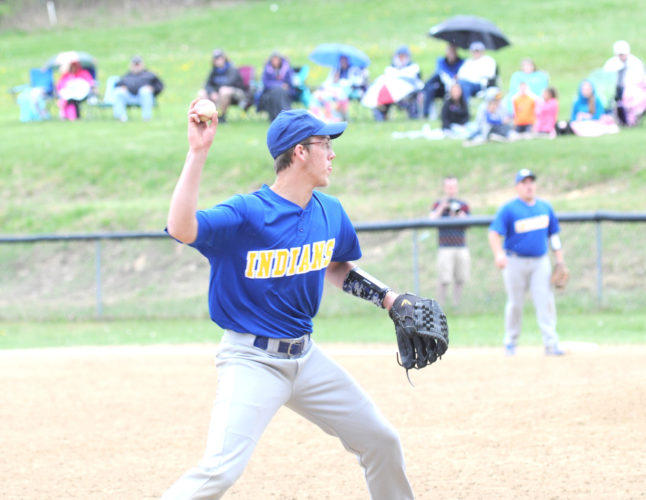 Southern Local third baseman Ethan West (left) feilds a play against Lisbon on Monday. (Photo by Chris Rambo)