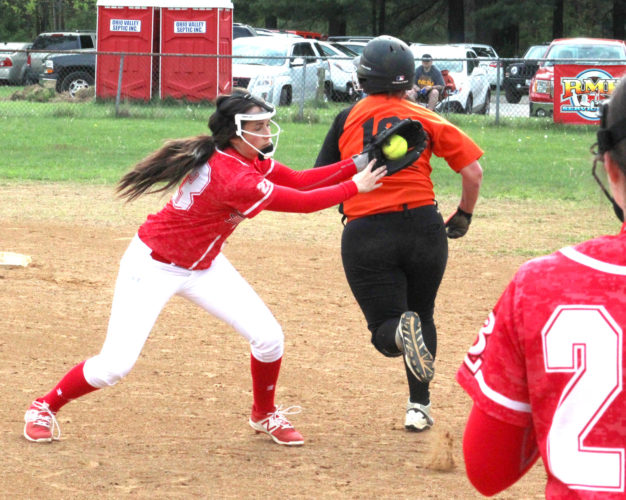 Beaver Local's Hannah Call tags out Wellsville's Madisyn Duck on Tuesday at Hammond Park. (Photo by Joe Catullo)