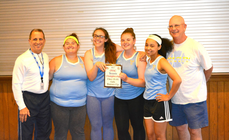 Members of the Oak Glen girls tennis team pose with the OVAC Class 1A-4A runner-up trophy Tuesday in Wheeling. Pictured are (from left) tournament director George Frazier, Molly Swartzmiller, Brooke Provenzano, Katie Szymanski, Cristal Tetrault, and Coach Ken Keller. Not pictured is Ally Brothers and Abby Chavez. (Submitted Photo)