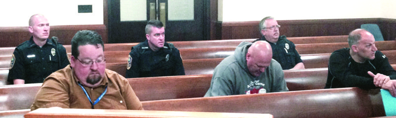 Police officers attend Tuesday's meeting of city council's finance committee. (Photo by Jo Ann Bobby-Gilbert)