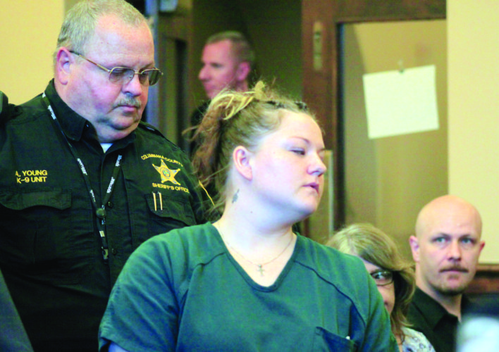 Danielle Heckathorn is led into the courtroom by sheriff's Deputy Lt. Allan Young prior to her sentencing. (Photo by Deanne Johnson)