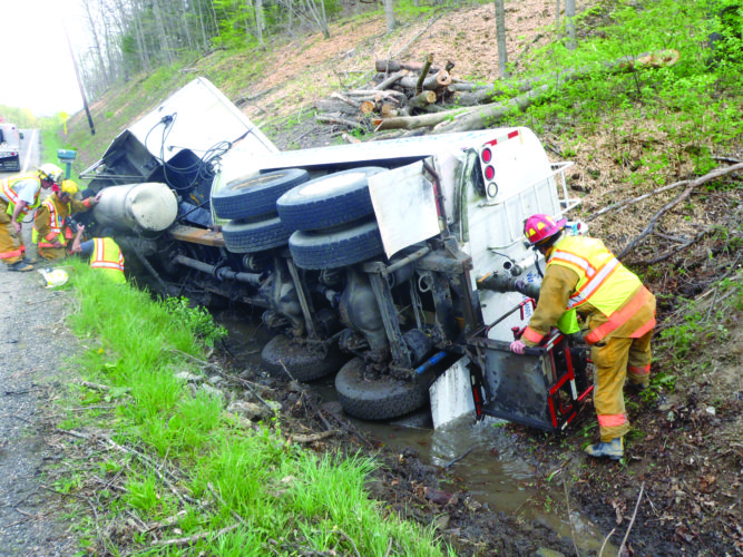 A mini-tanker from Brickner Water Transport went off the road and overturned in a ditch on state Route 154 about a mile north of Elkton at 9:07 a.m. Thursday. The driver, Fred Brickner of Lisbon, reportedly injured his arm in the accident and was taken to a local hospital by his wife. The county's hazardous materials response team was called in because about 20 gallons of fuel had spilled into the ditch. (Photo by Tom Giambroni)