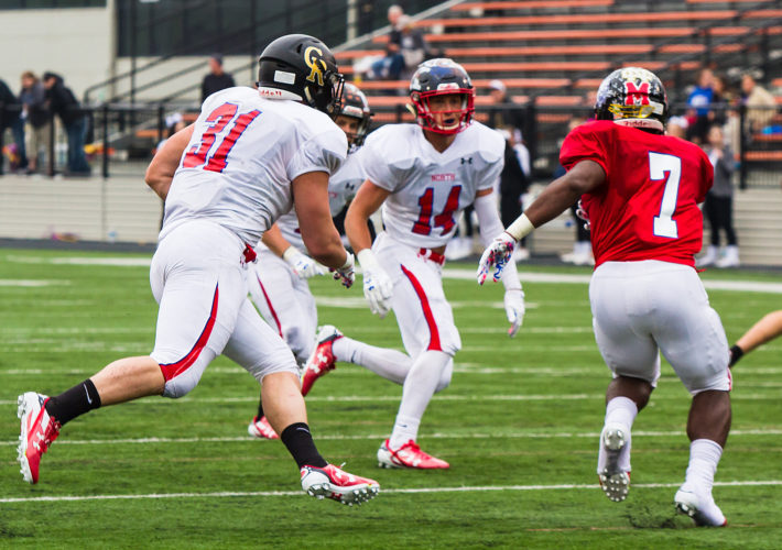 Crestview's Jordan Murphy and JFK's Evan Boyd chase down Marquette Dixon during the Division IV-VII North-South game at Massillon's Paul Brown Tiger Stadium on Saturday. Boyd's father is an East Liverpool graduate. (Photo by Wayne Maris)