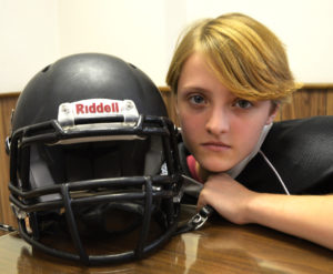 Salem seventh grader Anna Goodwin puts on her best game face. The well-rounded 12 year-old is a member of the junior high football team. (Salem News photo by J.D. Creer)