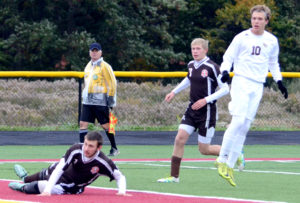 South Range's Brandon Youngs scores the third of his fourth goals against East Palestine on Saturday in a Div. III tournament game. Also shown are Ben Frazier and Blaze Egan. (Salem News/Patti Schaeffer)