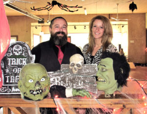Social 45 will formally open this weekend with a Halloween party on Saturday from 8 p.m. to 12:30 a.m. Social 45 is located at 6885 state Route 45, in the former Csonka's Sports Complex, and will also hold its first Queen of Hearts drawing at 6 p.m. Sunday, owner Jennifer Booth said. Bar manager Jeremiah Begley and Social 45 event coordinator Mea Myers are pictured getting the Halloween spirit rolling in preparation for the grand opening and Halloween party on Saturday. A costume contest will award $100 for first, $50 for second and $25 for third place for best costumes. (Salem News photo by Larry Shields)