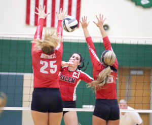 Salem's Chloe Cheresne splits the Northwest duo of Kim Zickefoose and Abbie Swaino on Tuesday at West Branch High School.