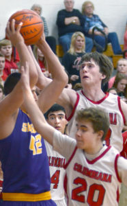 Columbiana's Burdette Baker (right, 33) and Hunter Zentner (20) block Sebring's Gabe Lanzer (42) from passing on Tuesday.. Also shown is Columbiana's Jared Wilson (4). (Salem News/Patti Schaeffer)