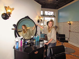 Shelby Shambach has opened Beauty on Broadway, a state-of-the-art beauty salon currently offering three beauticians and an aesthetician, along with two pedicare stations and custom-fitted shampoo sinks that are very easy on client necks. Located at 303 S. Broadway Ave. in Salem, Beauty on Broadway is by appointment only at 234-575-7244. Shambach is shown adjusting a mirror at one of the seven beauty stations in the completely renovated building. (Salem News photo by Larry Shields)