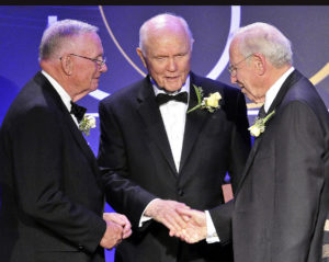 In this Friday, Aug. 29, 2008 file photo, astronauts Neil Armstrong, left, the first man to walk on the moon, John Glenn Jr., center, the first American to orbit earth, and James Lovell, right, commander of Apollo 13, stand at a gathering of 19 of the astronauts who call Ohio home in Cleveland. The gathering of Ohio astronauts was part of NASA's 50th Anniversary celebration. Glenn died Thursday at the age of 95. (AP Photo)