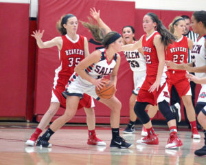 Salem's Ellie Davidson is trapped by Beaver Local's Emily Monte (35) and Madison Roberts (22) with Leah Menegos (33) looking for the pass on Thursday. Also shown is Beaver's Madison Cline (23). (Photo by Gary Leininger)