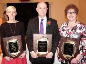 The Salem Area Chamber of Commerce hosted its annual meeting Friday afternoon at the Salem Golf Club. The chamber named Robert S. McCulloch III of Hunter Associates as Citizen of the Year in addition to D.T. Moore & Company as Business of the Year and Hannah E. Mullins School of Practical Nursing (HEMSPN) as Non-Profit of the Year. From left, Anita Wilson, payroll accounts administrator for D.T. Moore; McCulloch; and Tina Devlin, HEMSPN director. (Salem News photo by Kevin Howell)