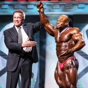 Arnold Schwarzenegger congratulates Kai Green, winner of the 2016 bodybuilding championship at the 2016 Arnold Classic in Columbus. (Photo courtesy of John Elias Aguirre)