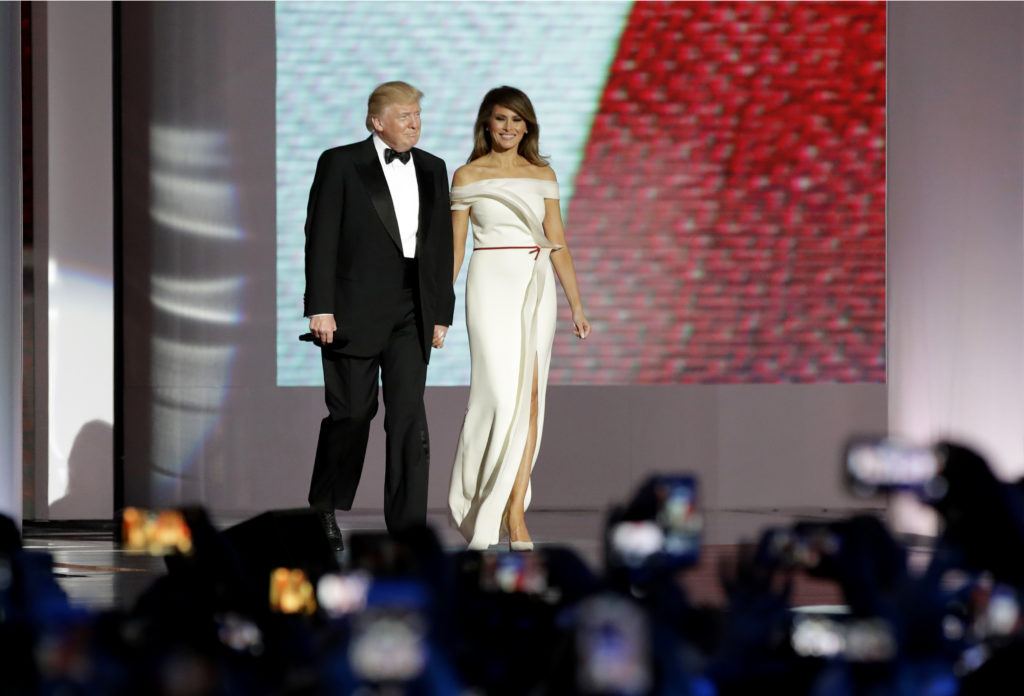 President Donald Trump, left, arrives with first lady Melania Trump at the Liberty Ball, Friday, Jan. 20, 2017, in Washington. (AP Photo/Patrick Semansky)
