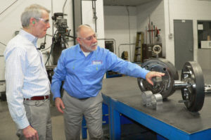 U.S. Sen. Rob Portman, R-Ohio, listens as Pennex Aluminum Technical Director Henry Bertolini leads him on a tour of the aluminum extrusion and fabrication facility at World Trade Park in Leetonia Friday. Portman spoke privately with company officials before touring the plant then holding a town hall session with employees.  (Salem News photo by Mary Ann Greier)