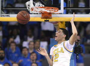 FILE - In this Saturday, March 4, 2017, file photo, UCLA guard Lonzo Ball dunks during the first half of an NCAA college basketball game against Washington State in Los Angeles. The UCLA freshman point guard has been one of college basketball's best players and could be the No. 1 pick in the NBA draft. He's kept up his high-level of play over the past month as his father, LaVar, has become more vocal in the media.  (AP Photo/Mark J. Terrill, File)
