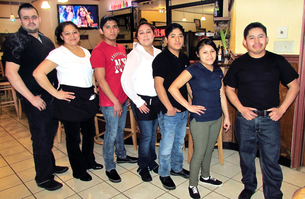 """The Rancho Viejo family restaurant opened two weeks ago at 377 S. Ellsworth Ave. offering """"food cooked differently"""" along with a bar with domestic and foreign beers. The staff  of Rancho Viejo includes, from left, Mario Curiet, chef; and servers Carmelina Huerta, Daiel Marcos, Claudia Cuellar, Abraham Manuel, Destiny M. Velo and Jose Marcos. Rancho Viejo changes food specials every day and offers booth or open table dining. (Salem News photo Larry Shields)"""