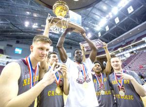 Kennedy Catholic players, from left, Marcin Wiszomirsky, Drew Magestro, Mohamed Konate, Clay O'Dell and Alex Hartwig celebrate after defeating Girard College in the 2017 PIAA, class 1A boys' basketball state championship game at the Giant Center, Thursday, March 23, 2017, in Hershey, Pa. (Mark Pynes/PennLive.com via AP)
