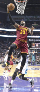 Cleveland Cavaliers' LeBron James (23) drives to the basket against the Charlotte Hornets during the first half of an NBA basketball game in Charlotte, N.C., Friday, March 24, 2017. (AP Photo/Chuck Burton)