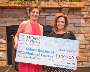 Julie Needs, Home Savings AVP/Branch Manager,  left, presents a $3,000 sponsorship check on behalf of the Home Savings Charitable Foundation to Anita Hackstedde, M.D., SRMC's President/CEO, at SRMC's seventh annual Hearts & Stars Gala. (Submitted photo)