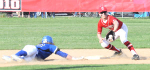 Lisbon's Colin Sweeney dives back to second as Columbiana's Chase Franken covers on Tuesday at Firestone Park. (Salem News/Chris Rambo)
